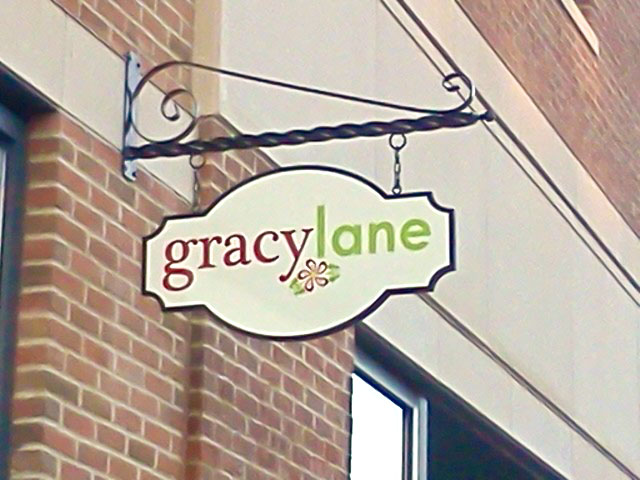 Gracy Lane Projecting Sign